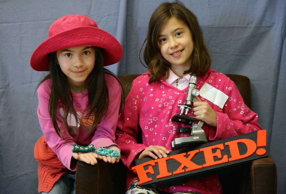 Young girls with microscope